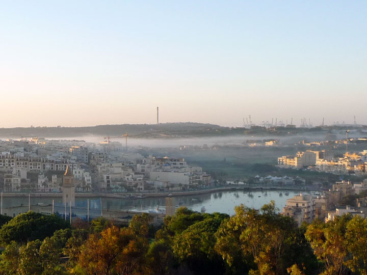 Marsaskala bay and Delimara chimney above white clouds on January morning, 2011, Malta